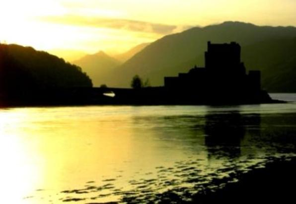 scottish_silhouette_castle_between_the_cloudscompressed.jpg